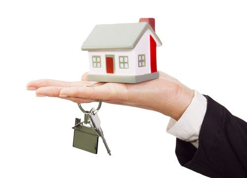 miniature-model-house-and-keys-resting-on-a-female-hand.jpg
